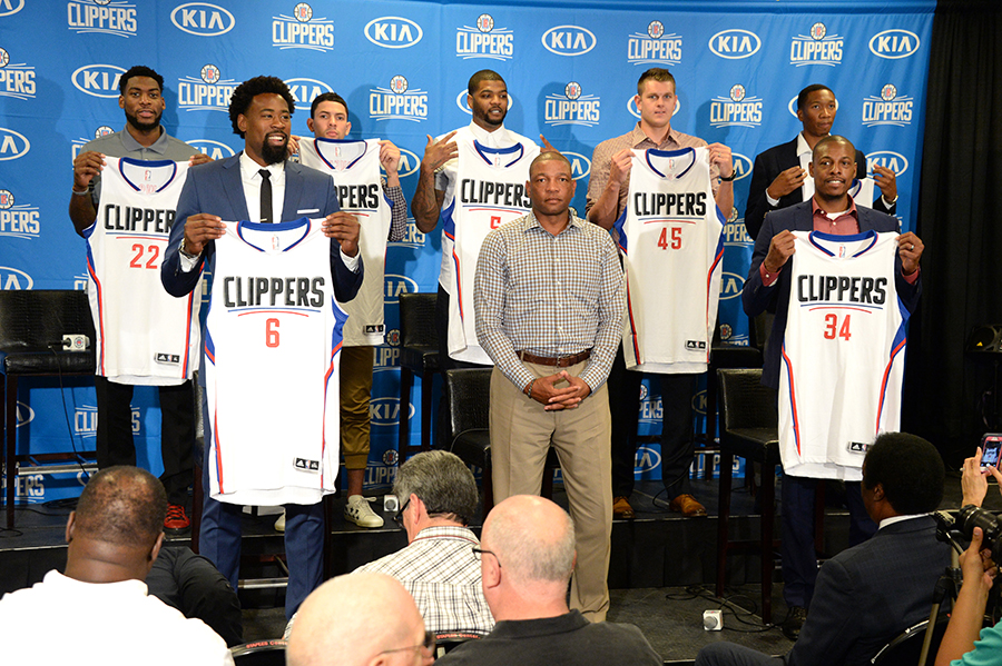 LOS ANGELES, CA - JULY 21: The Los Angeles Clippers hold up their jerseys at a press conference at STAPLES Center on July 21, 2015 in Los Angeles, California. NOTE TO USER: User expressly acknowledges and agrees that, by downloading and/or using this Photograph, user is consenting to the terms and conditions of the Getty Images License Agreement. Mandatory Copyright Notice: Copyright 2015 NBAE (Photo by Andrew D. Bernstein/NBAE via Getty Images)