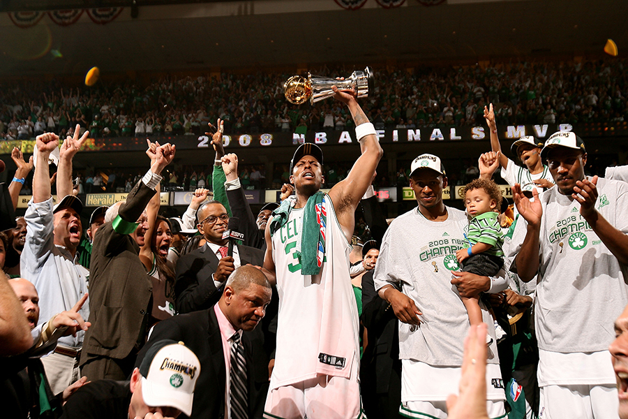 BOSTON - JUNE 17:  (L-R) Paul Pierce #34, Ray Allen #20 and James Posey #41 of the Boston Celtics celebrate with the Larry O'Brien championship trophy after defeating the Los Angeles Lakers in Game Six of the 2008 NBA Finals on June 17, 2008 at the TD Banknorth Garden in Boston, Massachusetts. The Celtics won 131-92 to capture the NBA Championship.  NOTE TO USER: User expressly acknowledges and agrees that, by downloading and or using this photograph, User is consenting to the terms and conditions of the Getty Images License Agreement. Mandatory Copyright: 2008 NBAE  (Photo by Nathaniel S. Butler/NBAE/Getty Images)