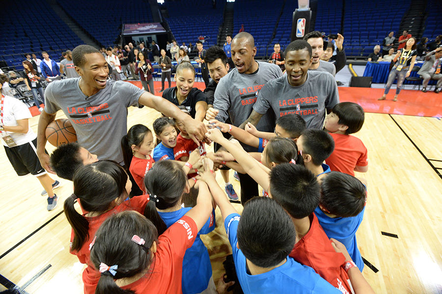 SHANGHAI, CN - OCTOBER 12: Wesley Johnson, Paul Pierce and Jamal Crawford of the Los Angeles Clippers interacts with the kids during a NBA Cares clinic as part of the 2015 NBA Global Games China at the Mercedes Benz Arena on October 12, 2015 in Shanghai, China. NOTE TO USER: User expressly acknowledges and agrees that, by downloading and or using this photograph, User is consenting to the terms and conditions of the Getty Images License Agreement. Mandatory Copyright Notice: Copyright 2015 NBAE (Photo by Andrew D. Bernstein/NBAE via Getty Images)